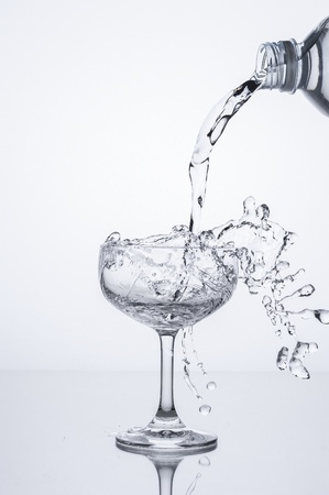 clear bottle: pouring water into glass