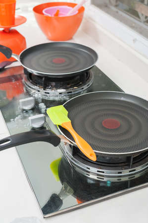 steel pan and silicone spatula on stove  photo