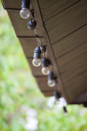 light bulb under eaves photo