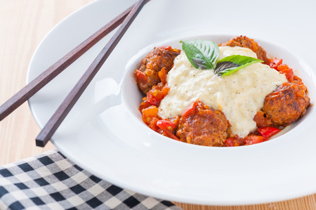 Spaghetti meat ball with red and white sauce in fusion style. photo