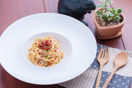 Carbonara pasta with bacon in white dish. photo