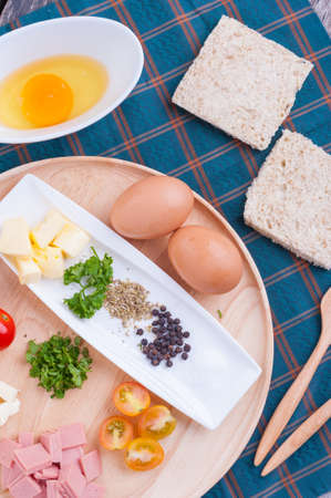 scramble: Ingredients for scramble egg on wood table. Stock Photo