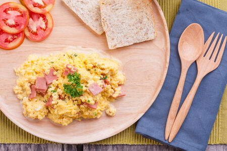 scrambled eggs with parsley and herbs and two slices of toast  photo
