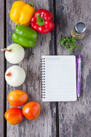 ingredients and notebook on wood table. photo