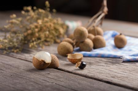 Longan (Dimocarpus longan.) on wood table. with low key scene. photo