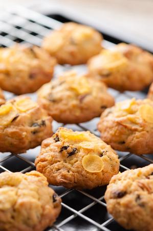 Raisin and cornflake cookies on tray. photo