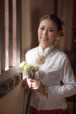 lowkey: Thai woman in retro style dress with lowkey scene. Stock Photo