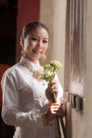 Thai woman in retro style dress with lowkey scene. photo