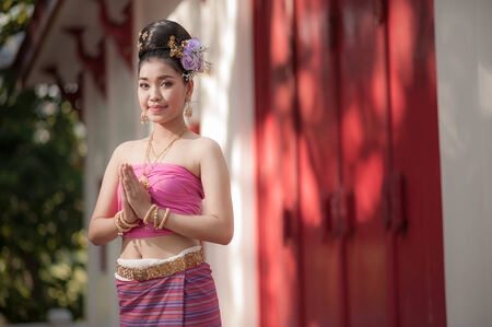 Asian woman wearing old-fashion lanna style cloth. photo