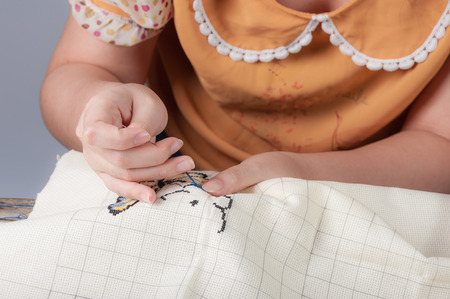avocation: Cross-stitch, a housewife hobby in spare time. Stock Photo