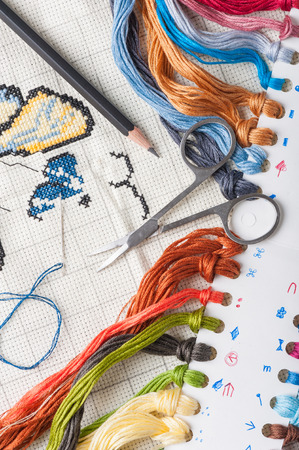 spare time: Cross-stitch, a housewife hobby in spare time. Stock Photo