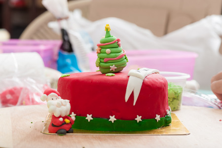 fondant fancy: Christmas concept fodant cake in kitchen.