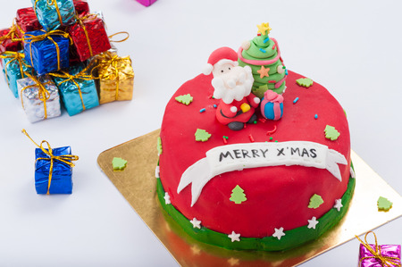 fondant fancy: Christmas concept fodant cake on white table.