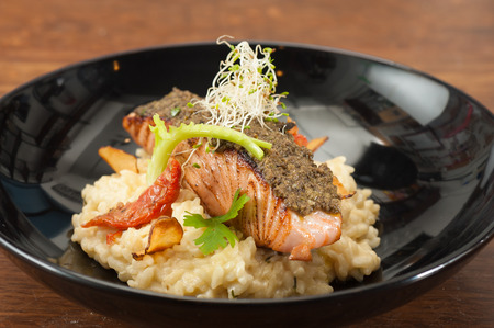 White wine lemon-sage risotto and sundried tomato with cured salmon tapenade, european fusion food