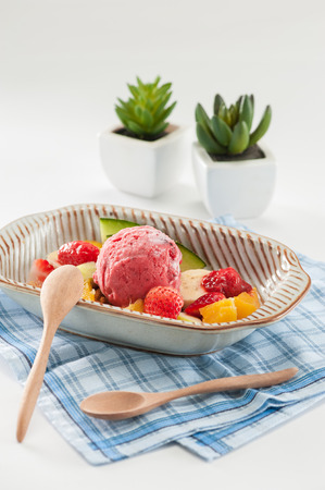 mixed fruits: Berry ice cream scoop with mixed fruits. Stock Photo
