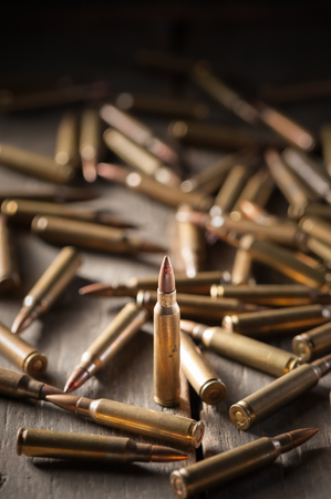 full jacket bullet: Rifle bullets on wood table with low key scene Stock Photo