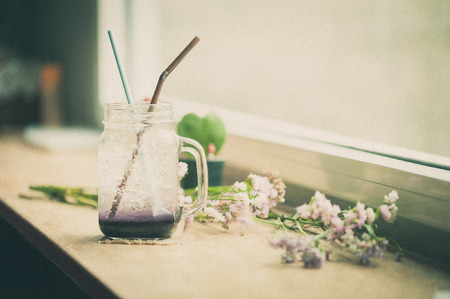 Italian soda on wood bar in cafe with film filter effect photo