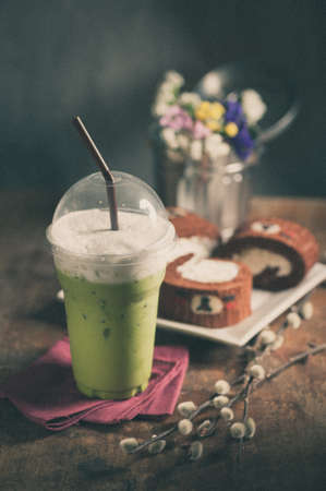 tea filter: Iced green tea latte on wood table with film filter effect Stock Photo