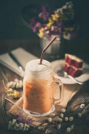 tea filter: Thai tea with milk cream in cafe with film filter effect