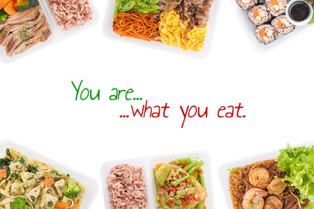 """""""You are what you eat"""" is written on white background with lunch box cooked by clean food concept (easy removable text)"""