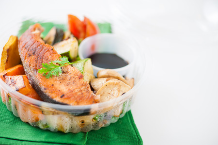 food preparation: Salmon steak and grilled vegetables cooked by clean food concept with Japanese sesame soy sauce in lunch box Stock Photo