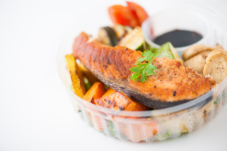 Salmon steak and grilled vegetables cooked by clean food concept with Japanese sesame soy sauce in lunch box Stock Photo