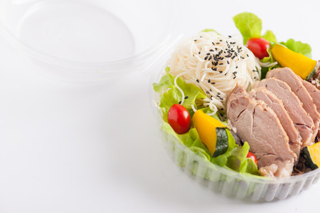 clean food: Salad with roasted pork and soba noodles by clean food concept in lunch box on white table