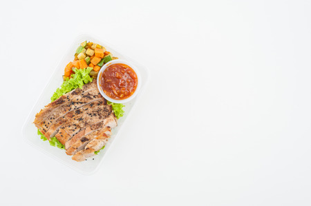 flavoured: Roasted pork with three flavoured (sweet, sour, spicy) sauce cooked by clean food concept with vegetables in lunch box