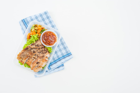 sweet and sour: Roasted pork with three flavoured (sweet, sour, spicy) sauce cooked by clean food concept with vegetables in lunch box