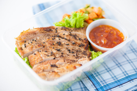 clean food: Roasted pork with three flavoured (sweet, sour, spicy) sauce cooked by clean food concept with vegetables in lunch box