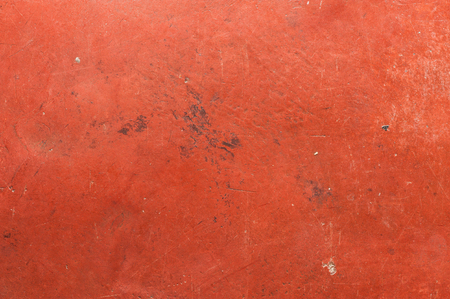 suface: Old red cement wall with scratch