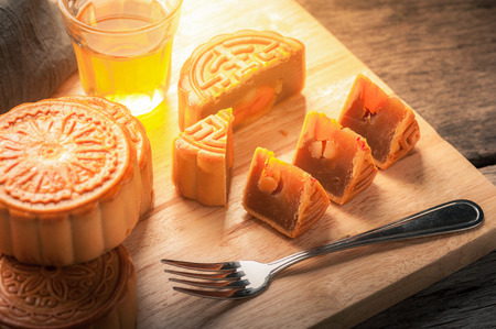 mid morning: Moon cake, Chinese mid autumn festival dessert on wood board with dramatic morning scene