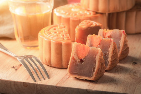 Moon cake, Chinese mid autumn festival dessert on wood board with dramatic morning scene Stock Photo - 44719985