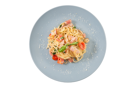 food       plate: Pasta with bacon and tomato in grey ceramic dish isolated on white background with clipping path Stock Photo