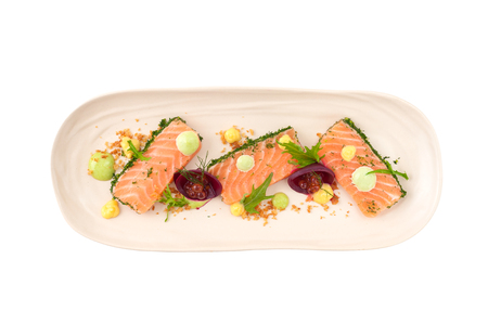 faked: Smoked salmon with herbs, beetroot, faked salmon roe (sauce cooked by molecular gastronomy technic) garnished with mago sauce and wasabi mayo isolated on white background with clipping path Stock Photo