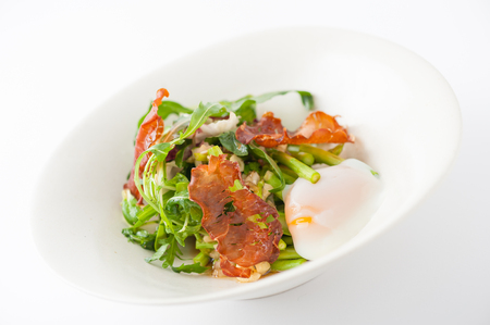 scald: Vegetables salad with balsamic vinegar dressing, onsen tamago (Japanese style scald egg) and smoked striploin ham 1.5 millimeters thickness in ceramic bowl, a modern cusine concept food Stock Photo