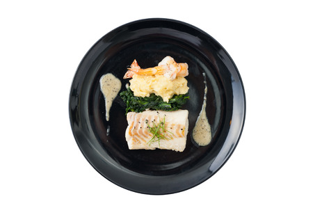 potato cod: Cod fish steak with shrimp, mesh potato, and vegetable, modern style food isolated on white background with clipping path
