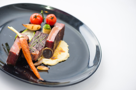 Dry-aged beef steak with mesh potato and vegetable, a modern style food