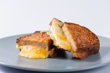 toasted sandwich: Toasted sandwich with various types of  cheese in ceramic dish Stock Photo
