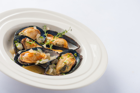 European style baked mussels with herbs in ceramic dish Reklamní fotografie