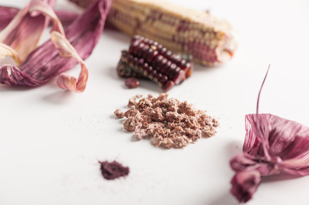 Black glutinous corn components on white table including kernels,  dried peels, feather powder and dehydrated corn cobs that can used to a wide range. Zero-waste kitchen and cooking concept Stock Photo