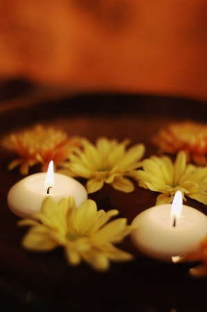 Close Up Of Aroma Bowl With Candles And Flowers photo