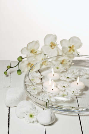 Aromatherapy bowl with white orchids Stock Photo - 19019672