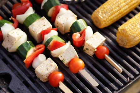 Vegetarian Barbecue,  marinated vegetables and tofu kebabs on a grill Stock Photo