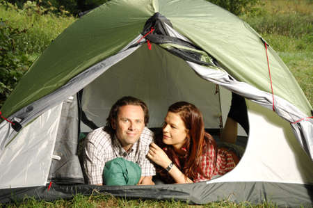 picknic: Couple in a tent, camping serie Stock Photo