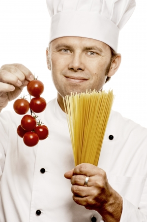 toque blanche: Chef with tomatoes and pasta, isolated on white Stock Photo