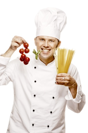 Chef with tomatoes and pasta, isolated on white
