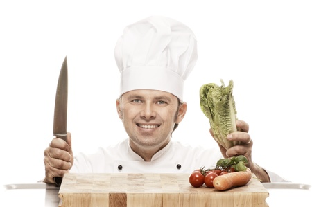 toque blanche: Chef with knife, cutting board and vegetables