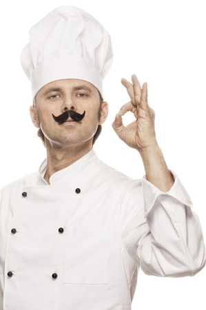 toque blanche: Chef doing a gesture of bongusto Stock Photo
