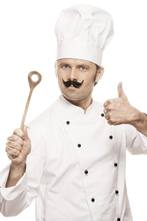 toque blanche: Chef with beard, wooden spoon and thumb up Stock Photo